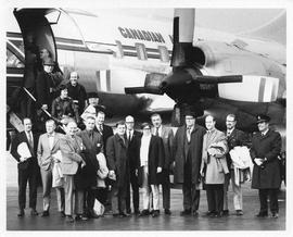 Photograph of Henry Hicks and a group of unidentified people boarding a CAF aircraft
