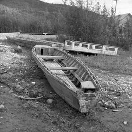 Photograph of old boats sitting on the land near Dawson City, Yukon