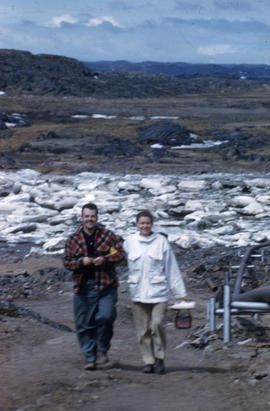 Photograph of Barbara Hinds walking with an unidentified man in Frobisher Bay, Northwest Territories
