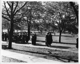 Photograph of scientists and distinguished guests walking outside