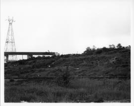 Photograph of train tracks and the MacKay Bridge on-ramp under construction