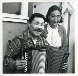 Photograph of Jimmy Koneak and his wife with an accordion