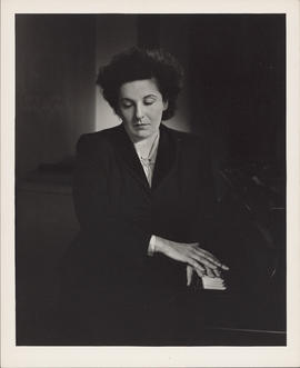 Photograph of Ellen Ballon with a piano