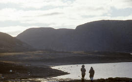 Photograph of Barbara Hinds and Allie looking at the view in Cape Dorset, Northwest Territories