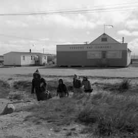 Photograph of people walking away from a Hudson's Bay Company store in Fort Chimo, Quebec