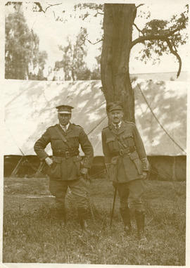 Two officers standing under a tree