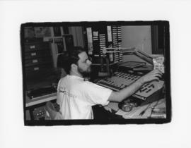 Photograph of an unidentified person in the master control room at CKDU Radio
