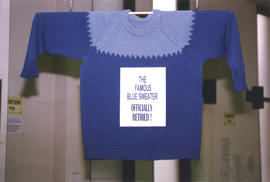 Photographs of Bill Owen's famous blue sweater on display for his retirement from the Kellog...