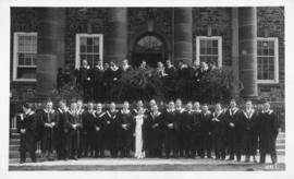 Photograph of a graduating class in front of the Arts Building
