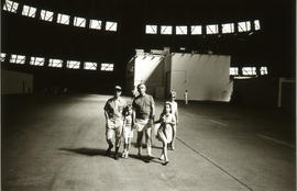 Photograph of a family walking inside a large building
