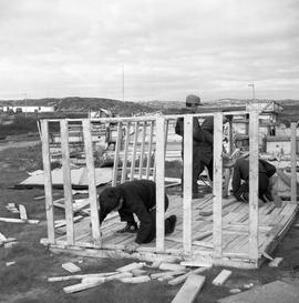 Photograph of children building a playhouse in Fort Chimo, Quebec