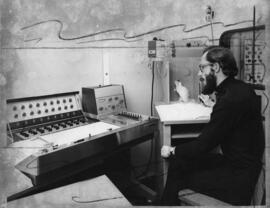 Photograph of Dr. Goddard and rat experiment