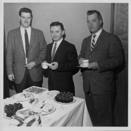 Photograph of Eastern Electric and Supply Company equipment installers Gordon Mills, Bernie James...