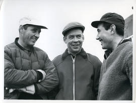 Photograph of Luke Dumas, Jacques Dumas, and George Koneak talking together