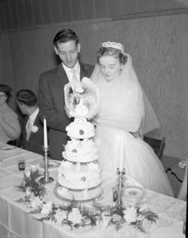 Photograph of Mr. & Mrs. Wright cutting the wedding cake
