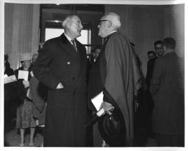 Photograph of two unidentified people in conversation