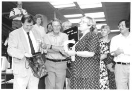 Photograph of W.K. Kellogg Library staff members and guests at Bill Owen's retirement party