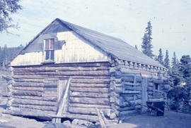 Photograph of a log cabin used by the Oblate mission, Newfoundland and Labrador