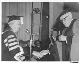 Photograph of Chancellor C.D. Howe shaking hands with an unidentified person