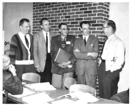 Photograph of five men at miscellaneous unknown health-related event