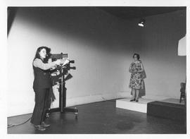 Photograph of an unidentified person filming a television segment