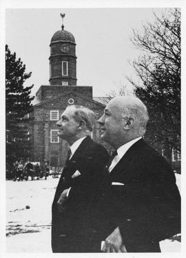 Photograph of Donald McInnes and Henry Hicks in front of the Henry Hicks Academic Administration ...