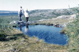 Photograph of three people walking by a pond near Fort Chimo, Quebec