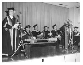 Photograph of A. E. Kerr, C. D. Howe, and others on stage