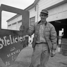 Photograph of Giles Dumas standing next to the open door of a Jeep in northern Quebec