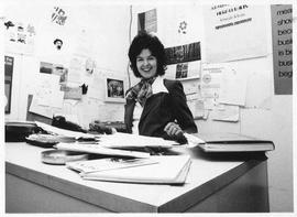 Photograph of Kate Carmichel sitting at a desk
