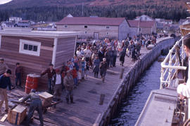 Photograph of a crowd of people on a dock watching a ship in Nain, Newfoundland and Labrador
