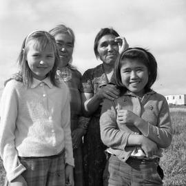 Photograph of Minnie Ananak, Jeannie Snowball, Jessie Koneak, and another girl in Fort Chimo, Quebec