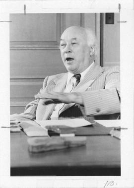 Photograph of Henry Hicks sitting at a desk
