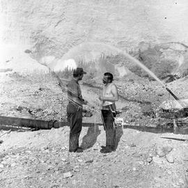 Double exposure photograph of two men at a quarry
