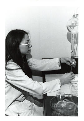 Photograph of individual conducting experiment in laboratory