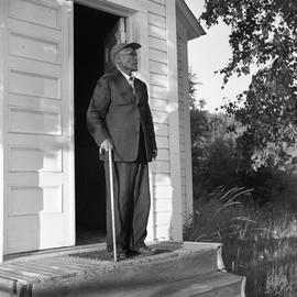 Photograph of an unidentified man with a cane