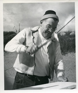 Photograph of Bill Walker hammering a nail