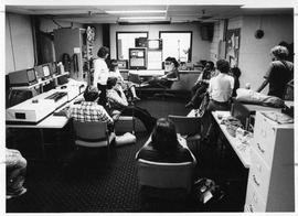Photograph of a group of students in the television control room.