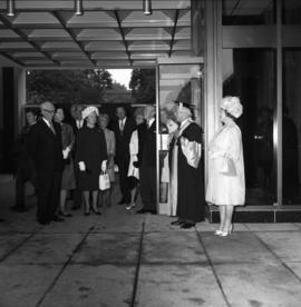 Photograph of the Queen Mother and Henry Hicks arriving at an event