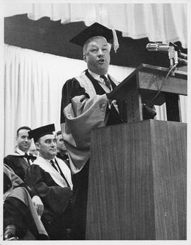Photograph of Henry Hicks speaking at a podium
