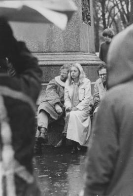 Photograph of Hilary Kitz and John Kitz sitting at the base of the Robert Burns statue in Victori...