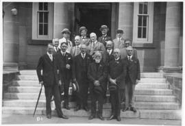 Photograph of a group of people on the front steps of the MacDonald Library