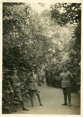 Three officers in the garden