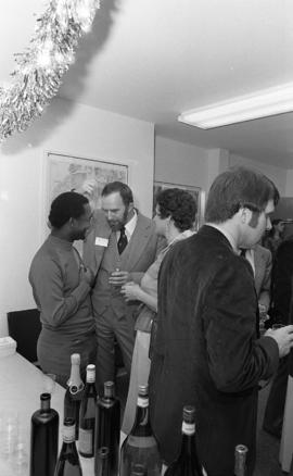 Photograph of people mingling at the opening of the Ocean Studies house