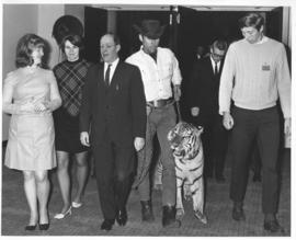 Photograph of attendees with a tiger at the opening of the Student Union Building
