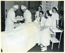 Photograph of doctors and nurses preparing to operate