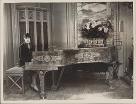 Ellen Ballon sitting at an ornate piano in London, England