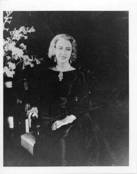 Three photographs and a photographic negative of Dorothy Killam