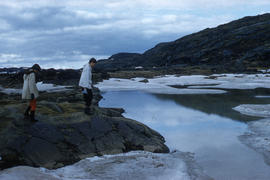 Photograph of Barbara Hinds and another woman walking by the water in Frobisher Bay, Northwest Te...
