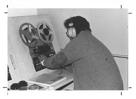 Photograph of Gerard Dolan transferring a lecture from video to audio tape